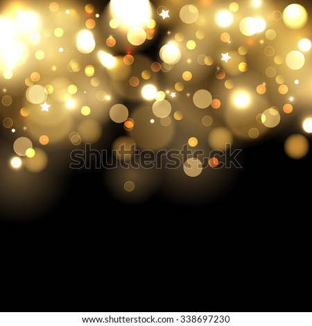 Gold bokeh lights on black background - stock photo