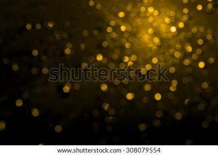 gold boken on black background - stock photo