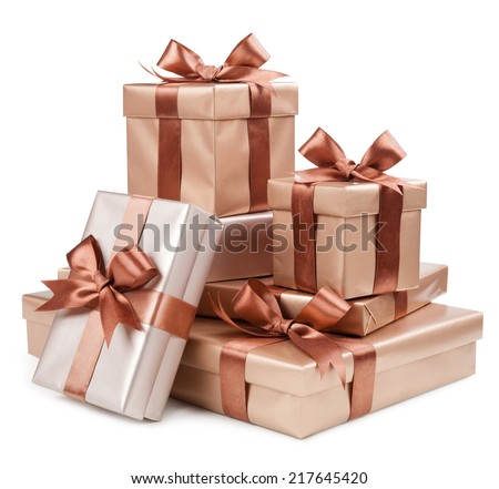 Gold box with gifts and brown bow  - stock photo