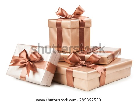 Gold box with gifts and brown bow isolated on white.