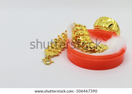 Gold bracelet in the red box on the white background ,jewelry and precious stone