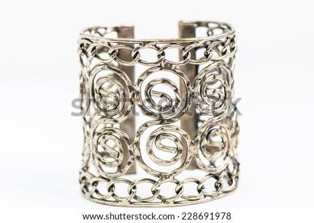 Gold bracelet isolated on white a background. - stock photo
