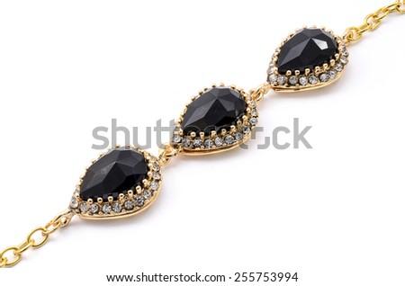 gold bracelet with black stone on a white background - stock photo