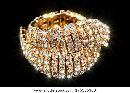 Gold Bracelet with Cubic Zirconia (CZ) on Black Background - stock photo