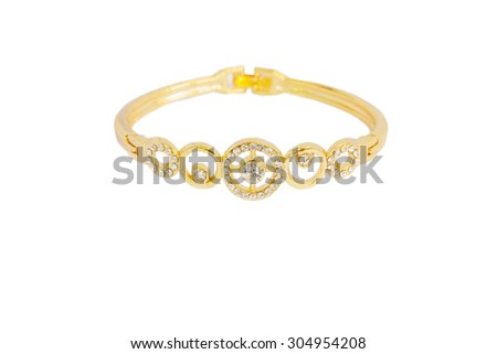 Gold bracelets adorned with diamonds. Fake jewelry. Clipping path in picture. - stock photo