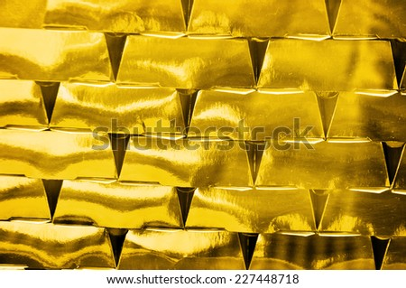 Gold bricks investment, golden background - stock photo