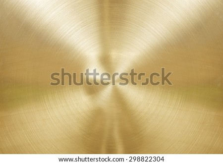 Gold brushed metal plate with reflections in circular. - stock photo