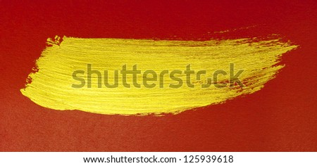 gold brushstroke on red