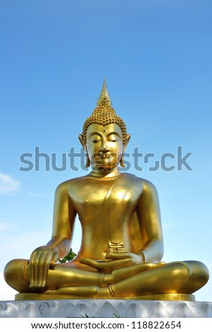 Gold Buddha portrait public outdoor on the sunny