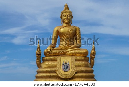 Gold Buddha statue on island in Thailand