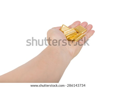 gold bullion in hand isolated on white - stock photo