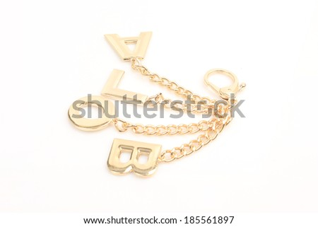 Gold chain against a white background