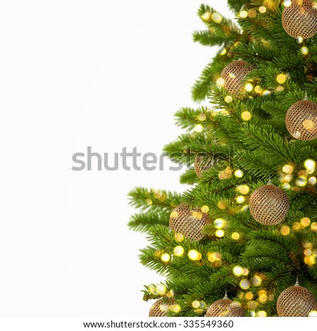 Gold Christmas background of de-focused lights with decorated tree - stock photo