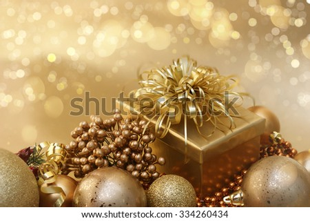 Gold Christmas background with decorations and bokeh lights