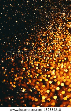 Gold Christmas background with sparkles and stars design