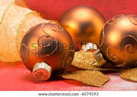 Gold Christmas Ball Ornaments on red.