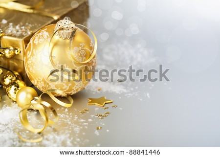 Gold christmas ball with gift box - stock photo
