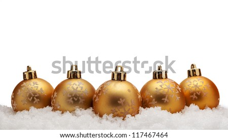 Gold christmas balls with snow isolated on white background - stock photo