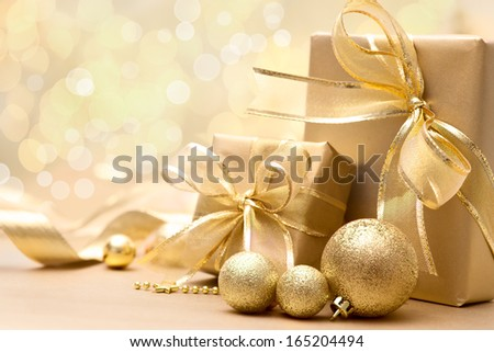 Gold Christmas gift boxes with bow and ribbon - stock photo
