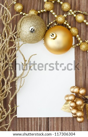 Gold Christmas ornaments on wood - stock photo