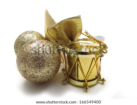 Gold Christmas tree ornaments, drum, ribbon and sparkly balls - stock photo