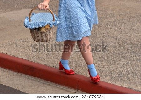 GOLD COAST, AUS -  NOV 06 2014:Dorothy Gale and Toto in Movie World Gold Coast Queensland Australia.Dorothy Gale was a fictional character of many of the Oz novels by the American author L. Frank Baum - stock photo