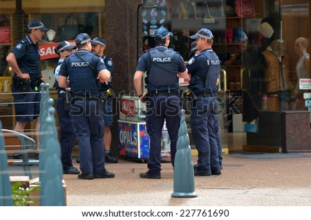 GOLD COAST, AUS - NOV 02 2014:Police officers patrols in Surfers Paradise. Gold Coast police on high terror alert warned to be hyper vigilant and patrol local mosques and critical infrastructure sites - stock photo