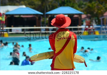 GOLD COAST, AUS - OCT 30 2014:Australian Lifeguard in Wet'n'Wild Gold Coast Australia.They are world-renown for their high levels of skill and knowledge in accident prevention and rescue response - stock photo
