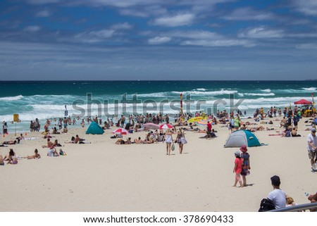 GOLD COAST, AUSTRALIA - FEBRUARY 14, 2016: People relax on the famous Surfers Paradise beach on a summer's day.