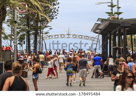 GOLD COAST, AUSTRALIA - JANUARY 5 2014: Gold Coast City Surfers Paradise on Cavill Ave  looking towards to the ocean where many  happy holidaymakers spend time with shopping. Jan 5 2014 Australia  - stock photo