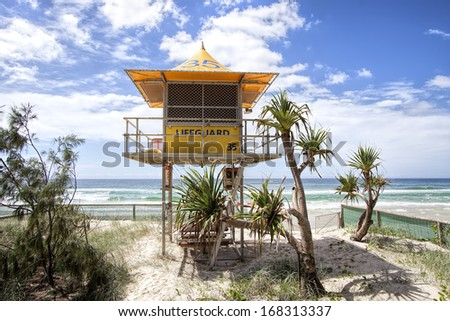 GOLD COAST, AUSTRALIA - MARCH 2013: Lifeguard patrol tower number 35 on the beach.There are currently 39 specially designed towers placed along Gold Coast beaches. March 23, 2013 Gold Coast, Australia
