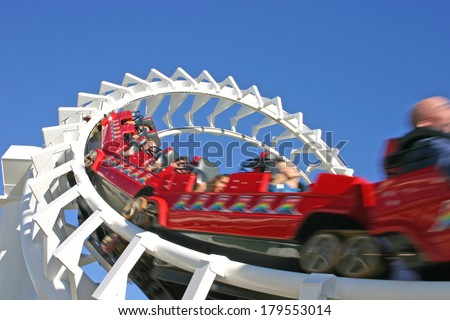 GOLD COAST, AUSTRALIA - October 7 2005: Roller coasters are one of the most popular fun rides in the world. LaMarcus Adna Thompson obtained a patent for roller coasters on January 20, 1885. - stock photo