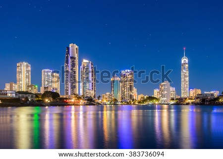 Gold Coast Beautiful Panorama Night view Skyline under Clear Blue Sky Illuminated Q1, CBD and Cityscape With Reflection In The Calm River Water, Surfers Paradise, Queensland, Australia - stock photo