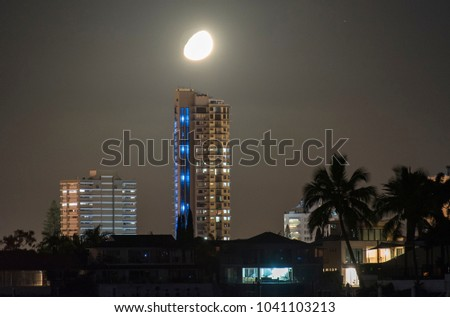 Gold Coast evening with moon near the buildings