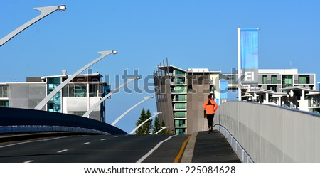 GOLD COAST - OCT 14 2014:Man runs over Ephraim Island bridge.It's a luxury residential development in Gold Coast, Australia.Some scenes for the feature film Jucy (2010) were shot on the island - stock photo