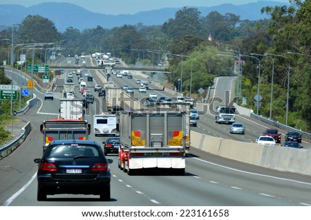 GOLD COAST - OCT 07 2014:Traffic on Pacific Highway..The Pacific Highway is a major transport route along part of the east coast of Australia and one of the busiest highways in Australia. - stock photo