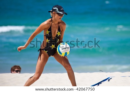 GOLD COAST, QUEENSLAND, AUSTRALIA - OCTOBER 21: Annual Beach Volleyball challenge between V8 racing drivers and Miss SuperGP finalists held in Surfers Paradise October 21, 2009 on the Gold Coast, Queensland, Australia