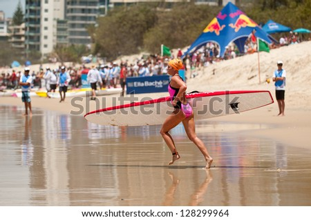 GOLD COAST, SURFERS PARADISE, QLD,  AUSTRALIA - FEB 9. 2013: A. Bennett (15) competes on the round four of the Surf Ironwoman Series National Championship on February 09th 2013, Gold Coast Australia. - stock photo