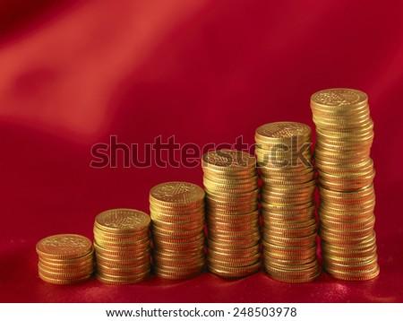 gold coin arranged forma graph - stock photo