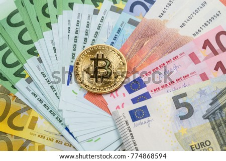 Gold coin bitcoin and various euro banknotes
