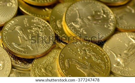 Gold coins, a rare precious metal to geologists and chemists and a symbol of value for economists and the worlds banks - stock photo