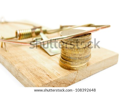 Gold coins in a mousetrap. On a white background. - stock photo