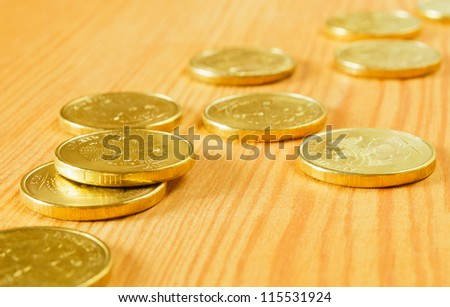 Gold coins of the table, close-up. - stock photo