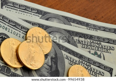 Gold coins on currency/Gold Coin and Currency/4 gold coins on paper currency