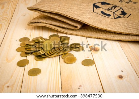 Gold coins on the background of wood