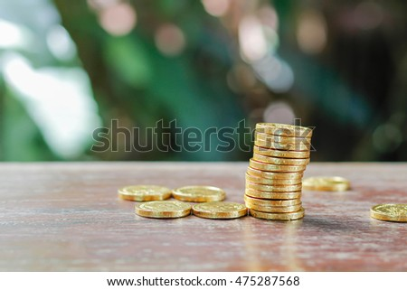 gold coins on wood background