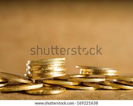 Gold coins over brown background - stock photo