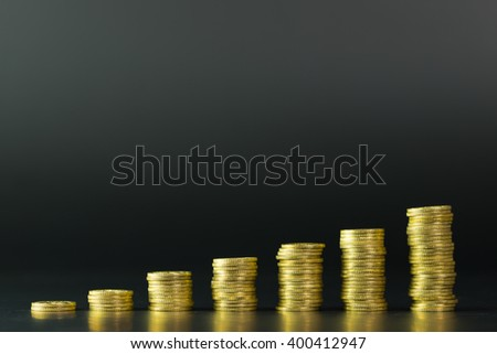 Gold coins stack in the moving up trend