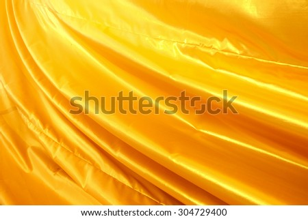 Gold color clothes fabric texture background.