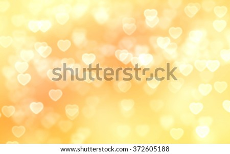 Gold color heart-shaped bokeh background - stock photo